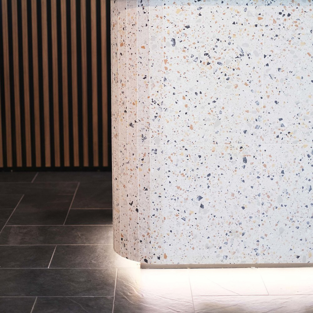 Tile Everything...our Ven Villa Ivory wrapped around custom counter fronts by @kiboconstructions . Floor tiles feature a custom lay pattern using our Stoneworks Nera Ardesia Natural. 🙌 #urbantileco #urbantilecompany #tilesbrisbane #commercialdesign #commercialfitout #tilesupplier #terrazzo #cabinetrydesign